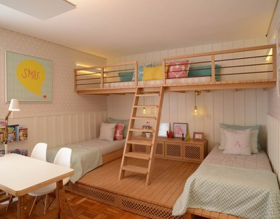 Beautiful bedroom for girls featuring a lofted playspace for both fun and rest