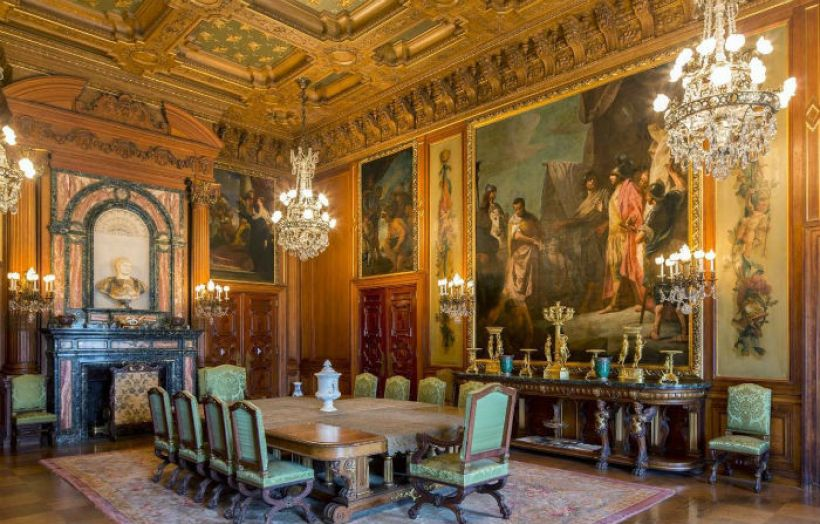 Amazing-dining-room-with-renaissance-interior-design-with-fireplace-and-chandeliers-and-sconces-and-wall-painting-and-large-dining-table-and-console-table-and-chairs