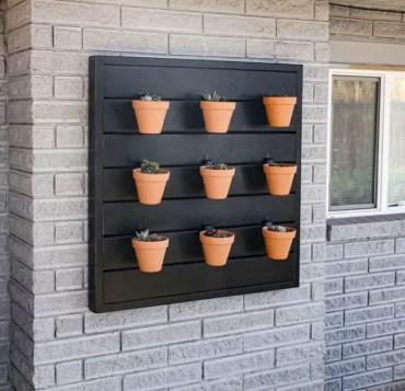 Backyard-vertical-garden-pots-on-exterior-of-house-683x1024-1