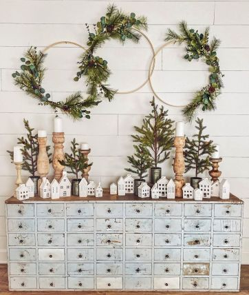 Farmhouse-winter-console-table-decor-with-white-houses-and-evergreen-hoops-via-@cottonstem-1
