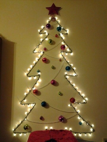 03-a-wall-mounted-tree-made-of-lights-beads-and-colorful-ornaments-plus-a-glitter-star-for-an-entryway-or-another-space