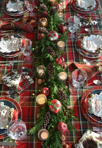 05-a-plaid-tablecloth-a-greenery-table-runner-with-pinecones-apples-plaid-ornaments-and-mercury-glass-candle-holders