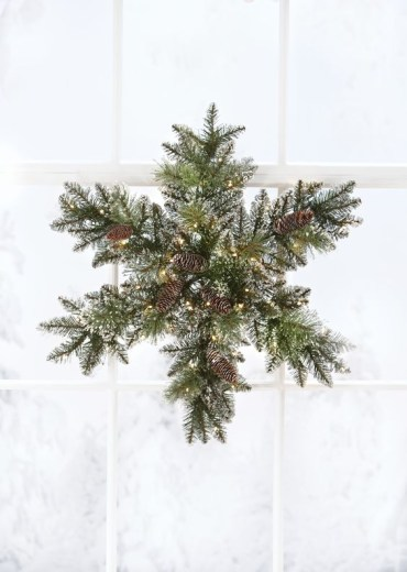 06-a-snowy-evergreen-christmas-wreath-with-pinecones-and-lights-shaped-as-a-snowflake