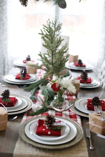 09-a-cozy-rustic-table-setting-with-a-plaid-runner-antlers-evergreens-and-pinecones-for-each-place-setting
