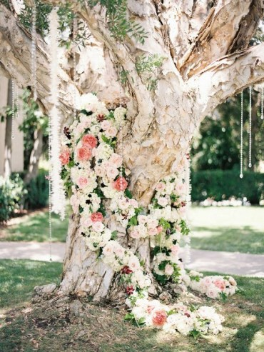 09-a-large-tree-covered-with-pastel-and-neutral-flowers-and-crystals