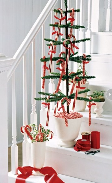 2 a-potted-christmas-tree-with-candy-canes-and-a-vase-with-greenery-and-candy-canes-will-make-your-space-look-festive-and-fun