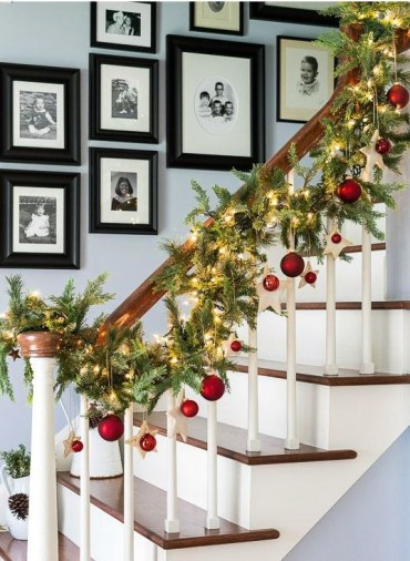 20-an-evergreen-garland-with-lights-stars-and-red-ornaments-to-line-up-the-stairs
