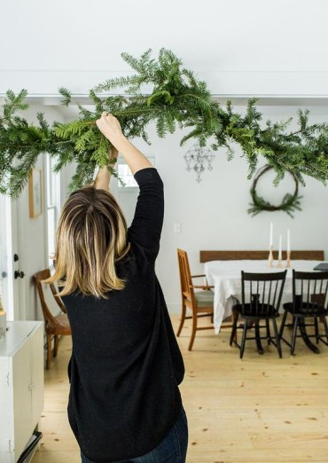 23-a-simple-evergreen-garland-attached-over-the-entry-to-the-dining-space