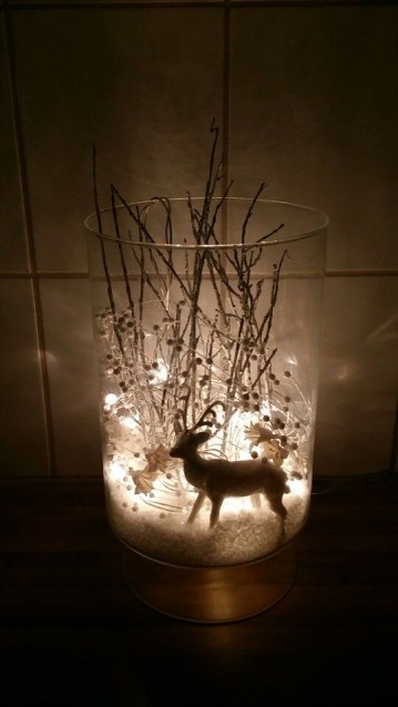 7 vase-with-fake-snow-white-reindeer-silver-trees-branches-and-white-pearl-decorations