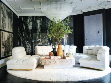 Beautiful-living-room-by-caroline-legrand-design-featuring-white-sofa-and-marble-walls