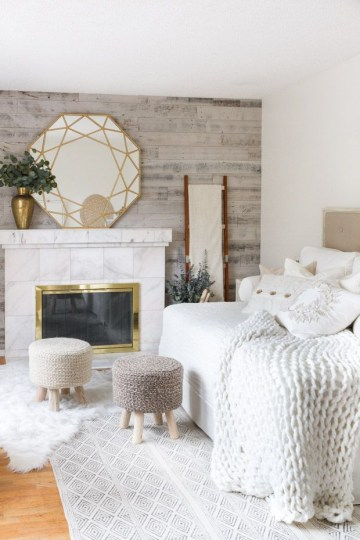 Chunky-knit-blanket-on-the-bed-and-knitted-stools-via-zevyjoy