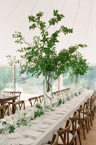 A-stylish-spring-wedding-reception-with-tall-greenery-centerpieces-white-blooms-and-candles-and-linens