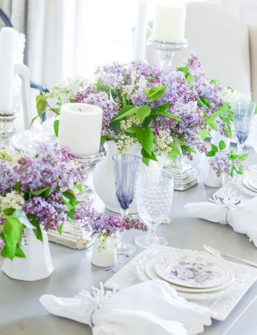 Welcome-spring-with-lush-lilac-centerpieces-candles-floral-plates-white-napkins-and-neutral-cutlery