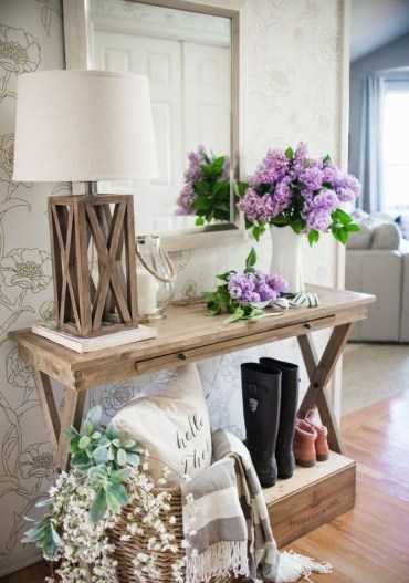 03-a-console-styled-with-fresh-blooms-and-a-basket-with-faux-blooms-and-greenery-for-a-farmhouse-space