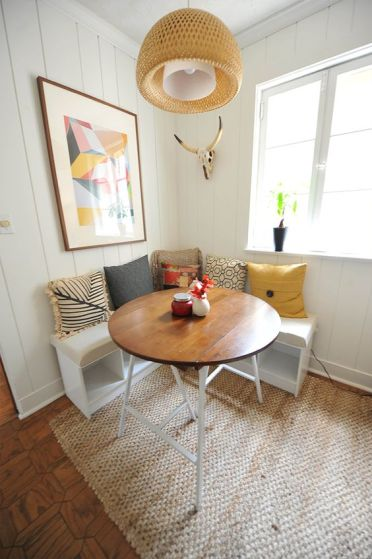04-modern-and-rustic-breakfast-nook-with-a-sisal-rug-and-a-wood-top-table