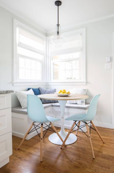 Breakfast-nook-with-modern-chairs-and-corner-bench-1