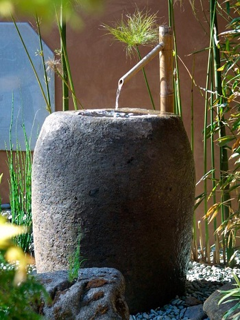Stone-colored fountain with bamboo water feeder Innovative Landscape Ideas For Water Features To Create A New Look