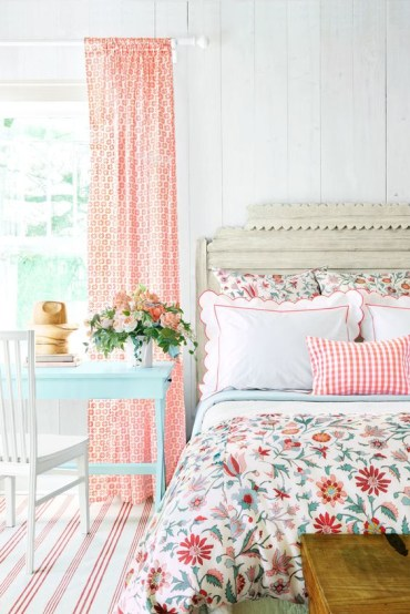 A-printed-curtain-floral-bedding-and-a-striepd-rug-plus-potted-blooms-make-the-bedroom-vintage-and-spring-like