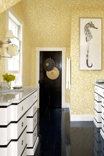 With sandy yellow wallpaper