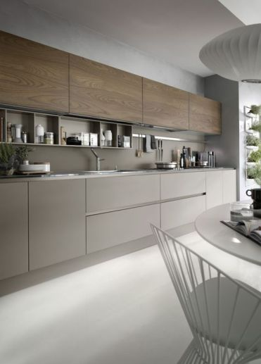 05-a-grey-kitchen-with-wooden-cabinets-and-a-grey-backsplash-with-built-in-shelves-and-nickel-touches-looks-very-contemporary