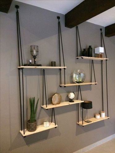 2-22-a-whole-hanging-shelving-unit-with-several-shelves-and-black-ropes-looks-very-contrasting-and-will-fit-any-boho-room