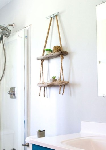 2-26-a-small-hanging-display-shelf-for-a-bathroom-made-of-driftwood-and-ropes-will-add-decorative-value-to-the-space-1