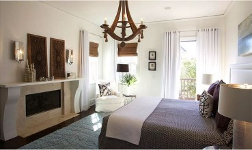 Bedroom with wooden chandelier