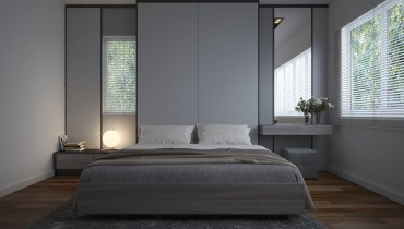 Grey-and-white-bedroom-with-mirrors-either-side-on-wooden-floor