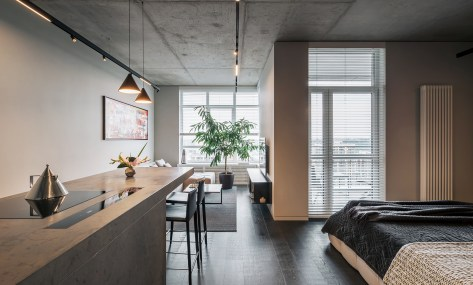 Minimalist apartment with a window overlooking the city 1