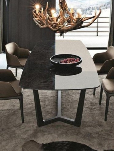 A-modern-chalet-dining-room-with-a-sleek-marble-dining-table-chairs-an-antler-chandelier-and-a-faux-fur-rug-1