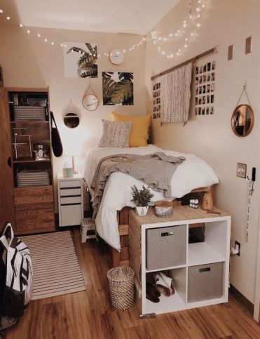 Bed-made-of-palettes-white-walls-with-art-and-polaroids-on-it-teenage-girl-bedroom-ideas-for-small-rooms-fairy-lights-hanging-from-the-ceiling
