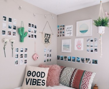 Framed-images-polaroid-photos-flowers-and-a-pink-camera-hanging-on-the-cream-walls-of-a-small-room-teen-bedrooms-pink-white-and-black-and-multicolored-cushions
