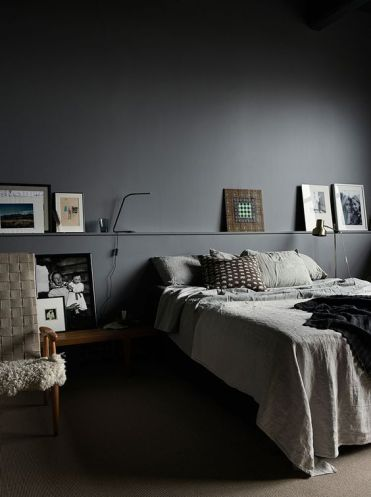 Graphite-grey-walls-functional-design-and-warm-woods-to-soften-the-look