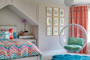 Round-swing-made-from-clear-plastic-in-a-room-with-white-walls-a-window-with-orange-patterned-curtains-nine-framed-artworks-cute-teen-rooms