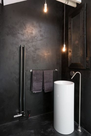 06-industrial-bathroom-with-a-white-free-standing-sink-that-pops-up