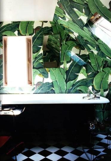 2-18-retro-inspired-bathroom-with-palm-leaf-print-wallpaper-and-a-black-bathtub