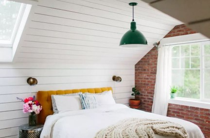 Attic bedroom with exposed bricks