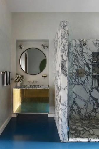 Dark and marble tile bathroom