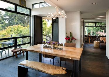 Dining-table-bench-with-natural-wooden-surface-complements-the-dining-table-in-a-fun-fashion