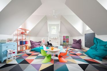 Geometric-rug-completely-transforms-the-ambiance-of-this-playroom-bedroom