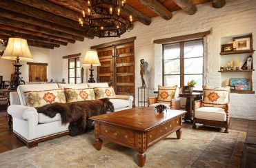 Heavy-wooden-beams-and-brick-walls-accentuate-the-southwestern-style-in-the-room