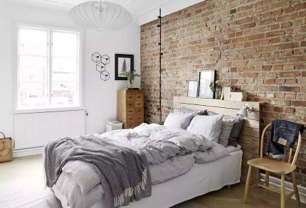 Natural wood and bricks bedroom