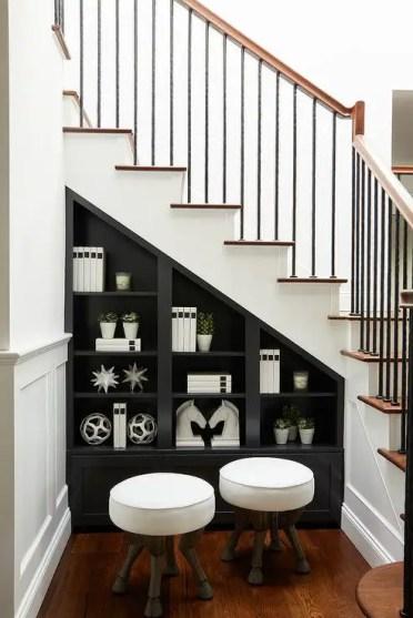 Black-built-in-shelves-under-staircase