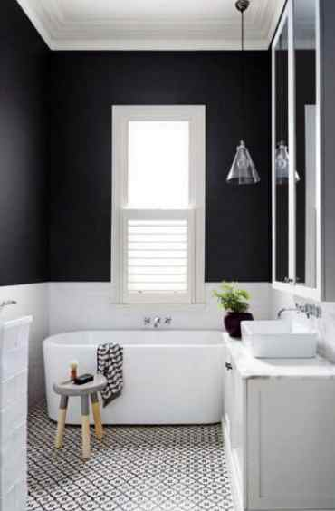 White-tub-tile-floors-black-bathroom-interior-design