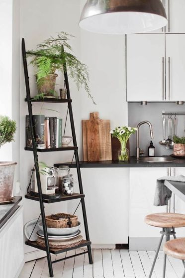 02-a-black-metal-and-wood-industrial-ladder-shelf-for-storage-in-the-kitchen-or-dining-space