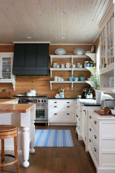 1-ceiling-and-rug-add-stripes-to-this-lovely-traditional-kitchen