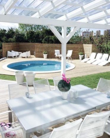 5-a-neutral-contemporary-space-with-loungers-and-white-garden-furniture-and-a-round-pool-clad-in-white-too