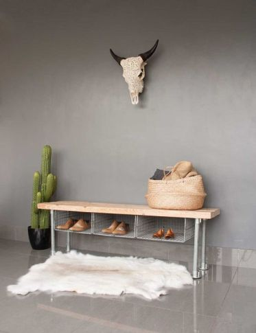 02-a-metal-shoe-rack-bench-with-wire-storage-compartments-and-a-wooden-top-for-an-industrial-space