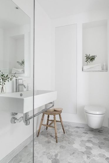 06-marble-hexagon-tiles-spruce-this-simple-bathroom-a-little-bit