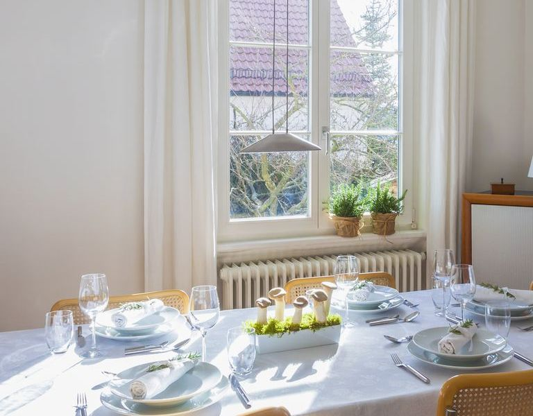1495675320-dining-room-table-windows-natural-light
